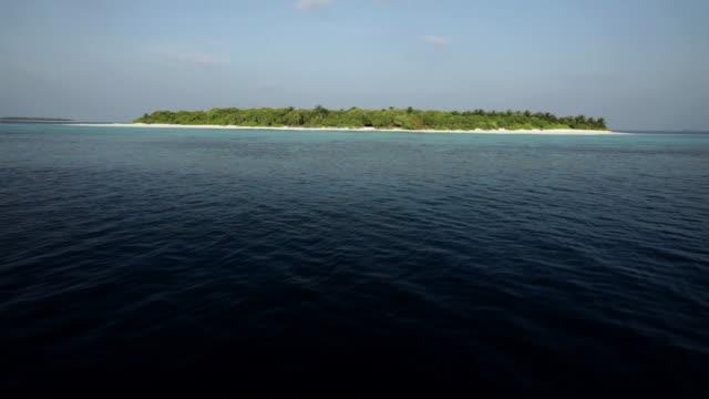 view of havodigalaa island, south huvadhu atoll, maldives - island stock videos & royalty-free footage