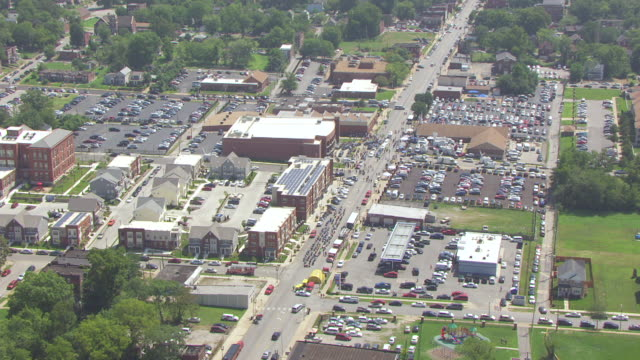 ws aerial ts view of hearse and crowd of people in front of friendly temple missionary baptist church / st louis, missouri, united states - baptist stock videos & royalty-free footage