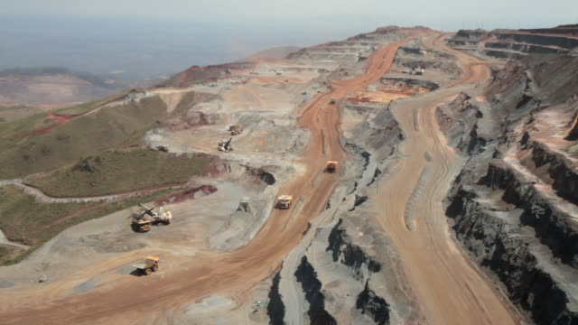 WS View of Heavy duty trucks working at mine landscape / Belo Horizonte, Minas Gerais, Brazil