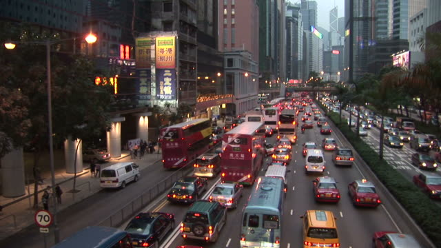 view of heavy traffic at magic hour in hong kong china - median nerve stock videos & royalty-free footage