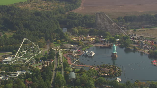 ws aerial view of heide park resort in soltau / germany - vergnügungspark stock-videos und b-roll-filmmaterial
