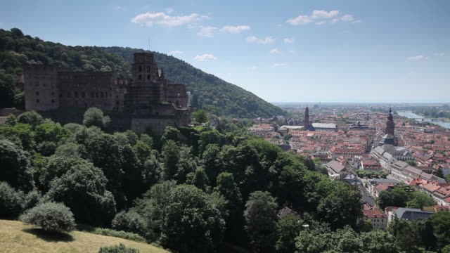 ws pan view of heidelberg castle and old town / heidelberg, baden-wã¼rttemberg, germany   - heidelberg castle stock videos & royalty-free footage