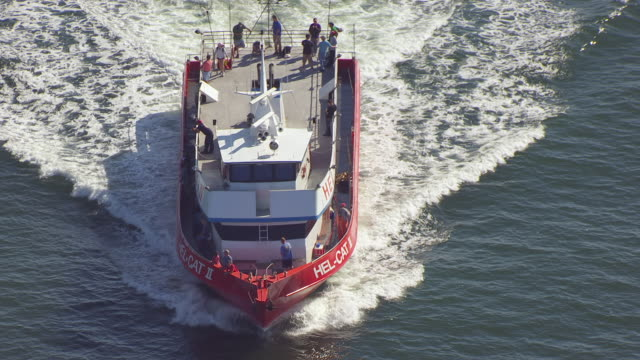 ws aerial pov view of hel-cat ii fishing boat in thames river/ groton, new london, connecticut, united states - new london county connecticut stock videos & royalty-free footage