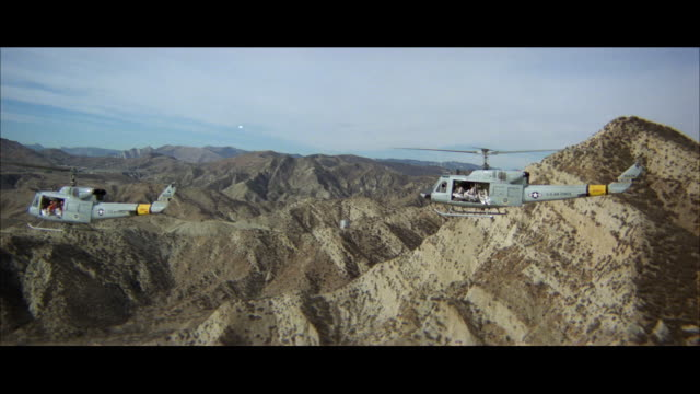 ws zi pan view of helicopter above mountain ranges at wilderness area - military helicopter stock videos and b-roll footage