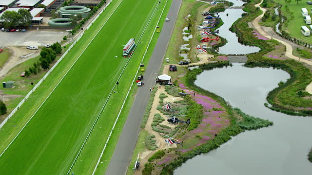 ws aerial zi view of helicopter at melbourne cup horse racing / melbourne, victoria, australia - pferderennbahn stock-videos und b-roll-filmmaterial