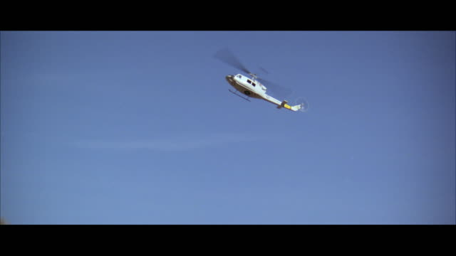 ws ts tu td view of helicopter crashing on mountain and exploding - ヘリコプター事故点の映像素材/bロール