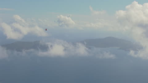 ws aerial zi ts view of helicopter flying on ocean / queensland, australia - hd format stock-videos und b-roll-filmmaterial