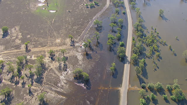 ws aerial view of helicopter flying over floods / griffith, new south wales, australia - flood stock videos & royalty-free footage