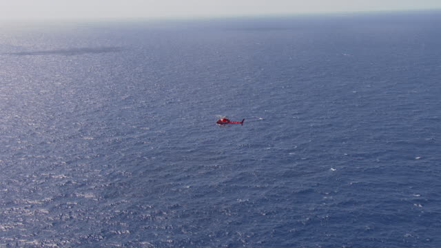 ws aerial view of helicopter flying over ocean / queensland, australia - hubschrauber stock-videos und b-roll-filmmaterial