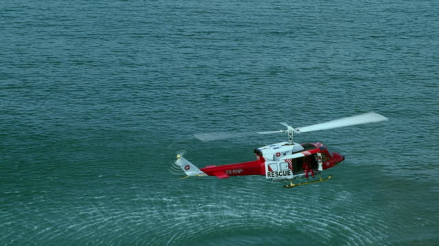 WS AERIAL View of helicopter hovering above ocean / Cape Town, Western Cape, South Africa