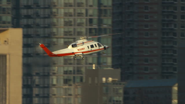 ws ts view of helicopter landing / new york city, new york, usa - helicopter landing stock videos and b-roll footage