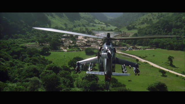 ws pov view of helicopter moving over mine camp in rainforest - military helicopter stock videos and b-roll footage