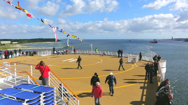 ws view of helipad on ferry ship with enjoying people at kieler forde / kiel, schleswig-holstein, germany - ponte di una nave video stock e b–roll