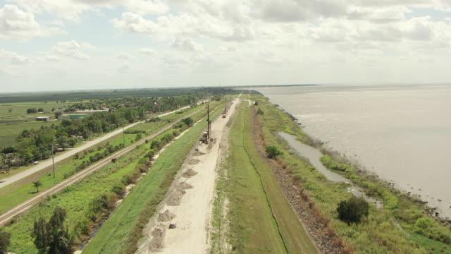 WS AERIAL View of Herbert Hoover Dike and Lake Okeechobee / Lake Okeechobee, Florida, United States