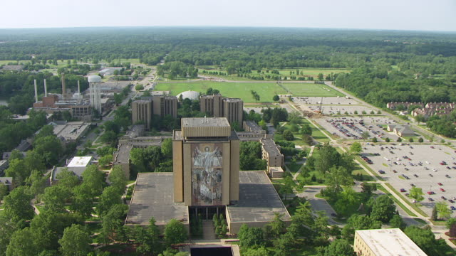 ws aerial pov view of hesburgh library / notre dame, st. joseph county, indiana, united states - indiana stock videos & royalty-free footage