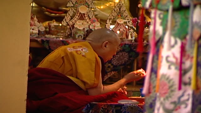 view of hh the dalai lama meditating while ringing a drilbu and carrying a dorje in tsuglagkhang temple the 14th dalai lama lives in exile in mcleod... - meditating stock videos & royalty-free footage