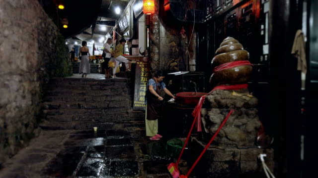 view of hibiscus town at night,hunan,china. - nachtmarkt stock-videos und b-roll-filmmaterial
