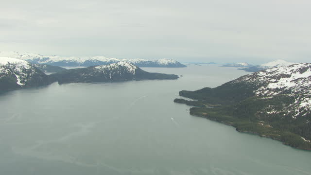 ws aerial view of high over boats in prince william sound / alaska, united states - prince william sound stock videos and b-roll footage