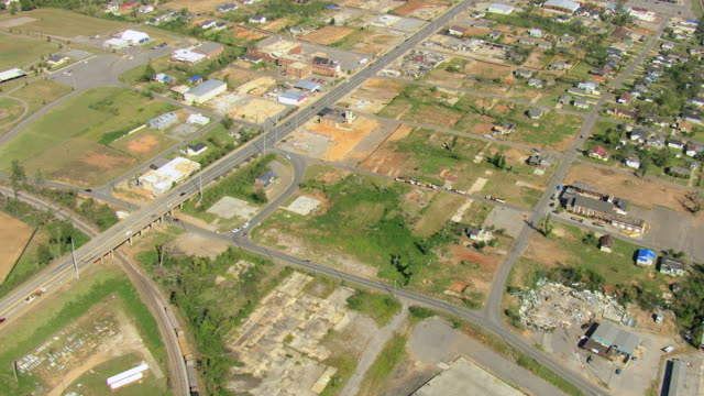 WS AERIAL TU View of high over Charleston Square Apartments site of destruction and path of tornado / Tuscaloosa, Alabama, United States