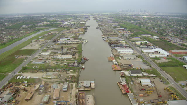 WS AERIAL View of high over industrial canal / Louisiana, United States