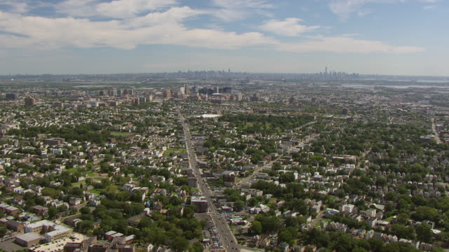 WS AERIAL View of high over Springfield avenue leading to downtown / Newark, New Jersey, United States