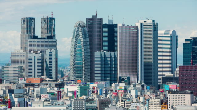 WS T/L View of high rise office and government buildings in business and shopping disctrict of Shinjuku / Tokyo, Japan