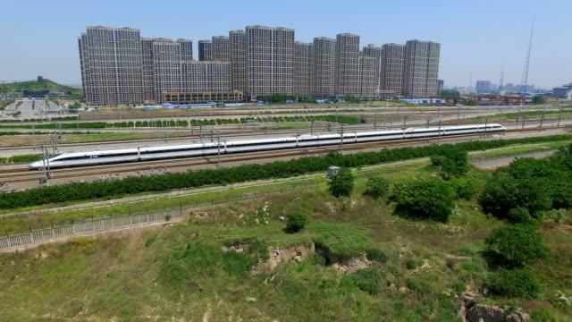 ws aerial view of high speed train driving on the rail,xi'an,china. - 高速列車点の映像素材/bロール
