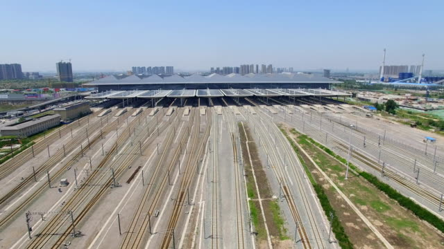 ws aerial view of high speed train driving on the rail,xi'an,china. - schienenverkehr stock-videos und b-roll-filmmaterial