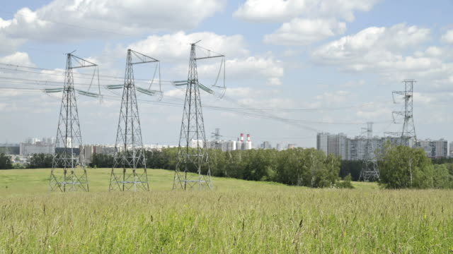 ws t/l view of high voltage transmission lines in field / moscow, russia - electricity pylon stock videos & royalty-free footage