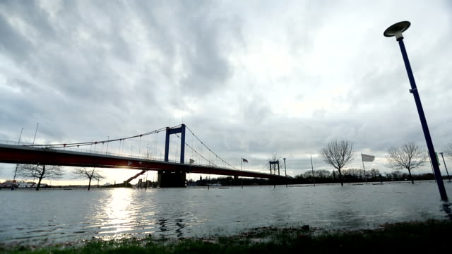 ws view of high water on the river rhein in duisburg / duisburg, germany - suspension bridge stock videos & royalty-free footage