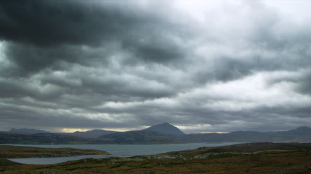 WS T/L PAN View of highland scenery by loch and mountains with clouds / Ben Hope, Scotland, United Kingdom