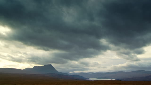 ws t/l pan view of highland scenery by loch and mountains with clouds / ben hope, scotland, united kingdom - loch点の映像素材/bロール
