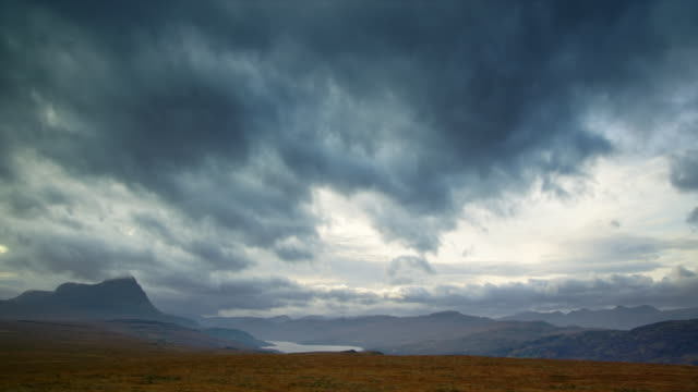 ws t/l view of highland scenery by loch and mountains with clouds / ben hope, scotland, united kingdom - loch点の映像素材/bロール