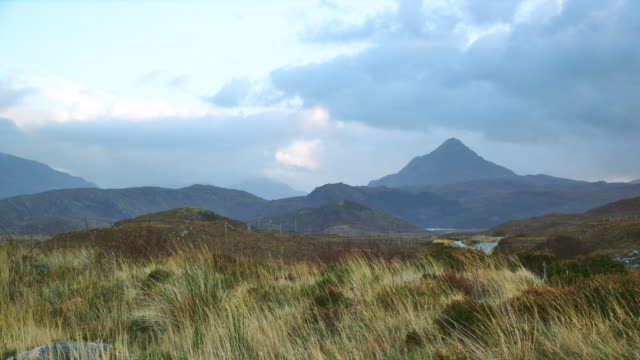WS View of highlands scenery with mountain and clouds / Drumbeg, Scotland, United Kingdom