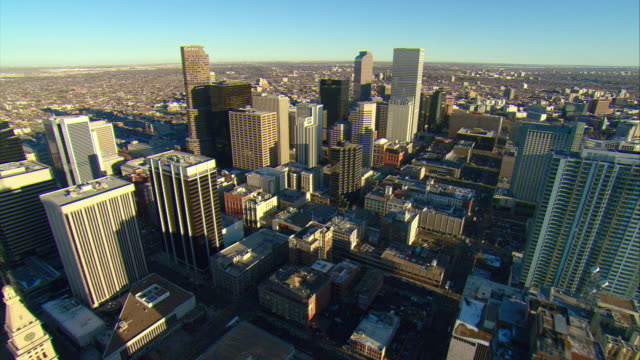WS POV AERIAL View of high-rise buildings of downtown Denver / Denver, Colorado, USA