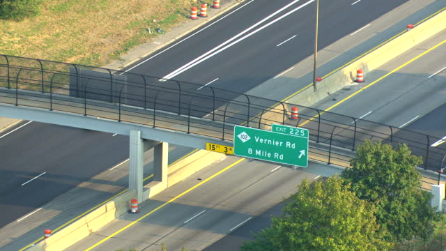 MS AERIAL View of  highway exit sign for 8 Mile Road / Detroit, Michigan, United States