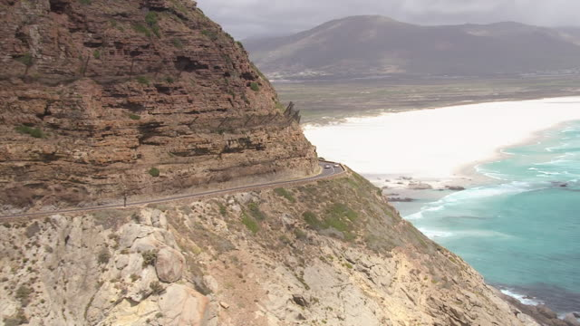 ws aerial zi ts view of highway on hill area, chapman's peak drive and noordhoek beach / cape town, western cape, south africa - convertible overhead stock videos & royalty-free footage