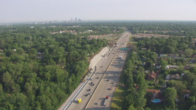 ws tu aerial pov view of highway with downtown indy in background / indianapolis, marion county, indiana, united states - indianapolis stock videos & royalty-free footage