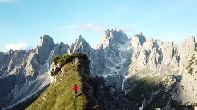 aerial view of hiker on the edge of a cliff - italy stock videos & royalty-free footage