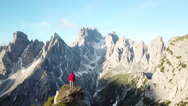 aerial view of hiker on the edge of a cliff - dolomites stock videos & royalty-free footage