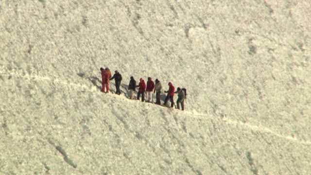 ws aerial view of hikers walking on summit of mount rainier / washington, united states - pierce county washington state stock videos & royalty-free footage