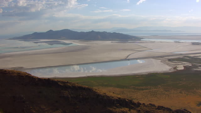 WS AERIAL View of hill to evaporation ponds and Stansbury Island at Great Salt lake / Utah, United States
