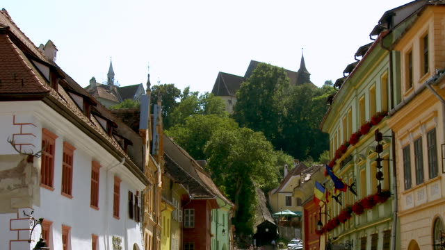 ms zo view of hill to historic hillside street with buildings /sighisoara, romania - sighisoara stock videos & royalty-free footage