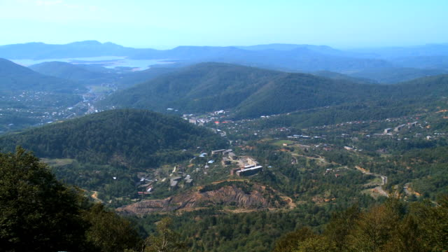 ws pan view of hill village / racha, georgia - laubbaum stock-videos und b-roll-filmmaterial