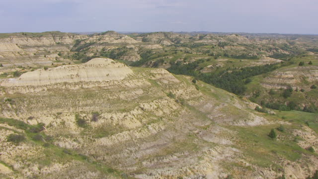 WS AERIAL View of Hills in Badlands in Theodore Roosevelt National Park / North Dakota, United States