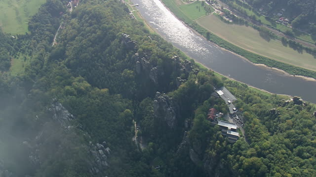 ws aerial zi view of hills rock and houses near elbe river / germany - river elbe stock videos & royalty-free footage