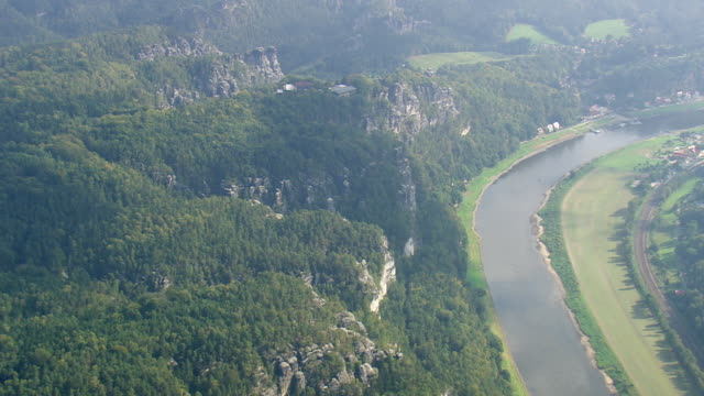 ws aerial view of hills rock and houses near elbe river / germany - river elbe stock videos & royalty-free footage