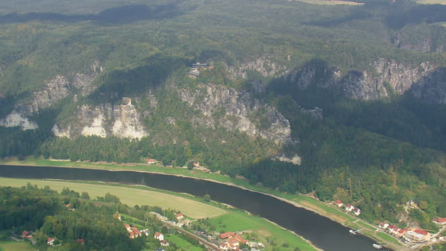 ws aerial view of hills rock with houses near elbe river/ germany - river elbe stock videos & royalty-free footage