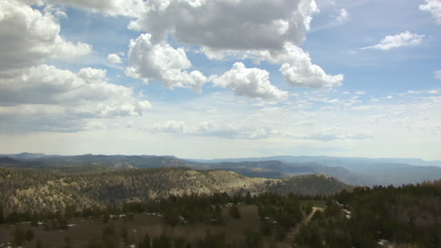 ws aerial view of hills under clouds at colorado plateau / utah, united states - colorado plateau stock videos & royalty-free footage