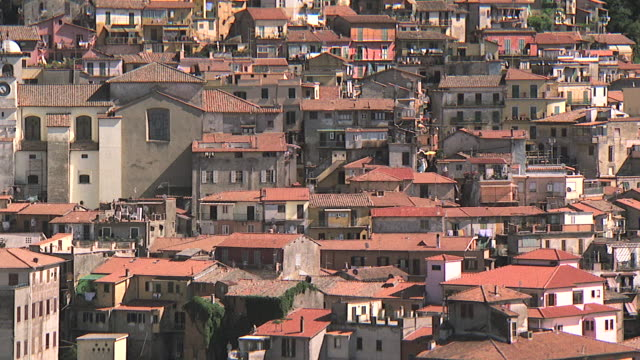 ws aerial view of hillside houses in small roman town / rome, italy - appartamento video stock e b–roll